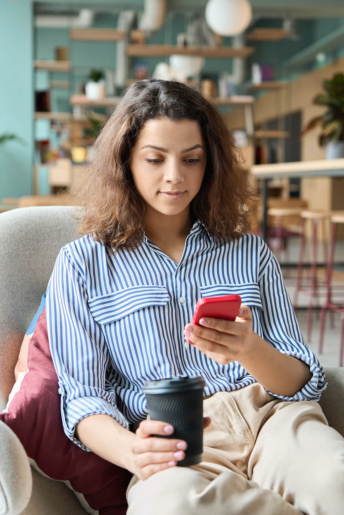 latin-teenager-girl-sitting-using-smartphone-app-l-FVBXU3Y (1).jpg